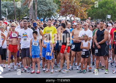 Miami Beach Florida Ocean Drive South Pointe 5K Run benefit runners race compete starting line man men woman boy girl father d - Stock Image