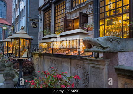 Amber shop display and carved water spout Mariacka Street Gdańsk Poland - Stock Image