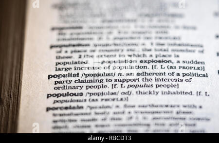Closeup of the word populist on a page inside an English language dictionary - populism concept - Stock Image