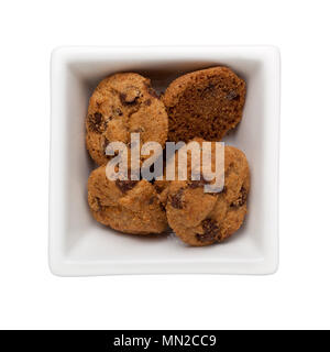 Chocolate chip cookies in a square bowl isolated on white background - Stock Image