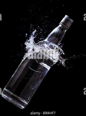 Alcohol bottle breaking - Stock Image