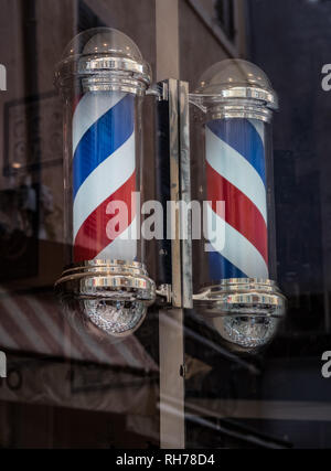 Traditional barber's pole in the town of Hyeres, France - Stock Image