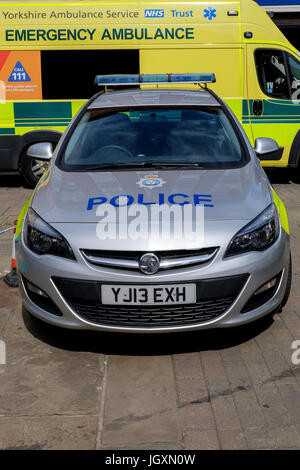 Police car and ambulance parked in the centre center of York, UK. - Stock Image