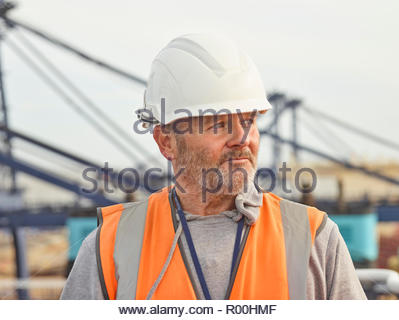 Dock worker with hard hat - Stock Image