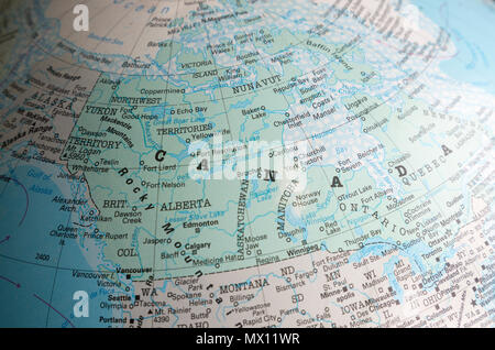 North America map on a globe focused on Canada and USA border - Stock Image