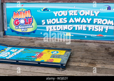 Mini Golf course that uses golf balls comprised of 100% fish food on Boscombe Pier at Boscombe, Bournemouth, Dorset UK in July - Stock Image