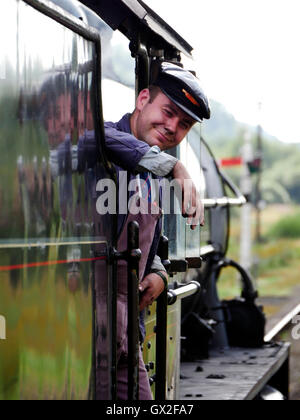 Engineer on a steam train at Goathland railway station Aidensfield North Yorkshire Moors England United Kingdom - Stock Image