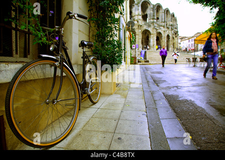Arles; Bouches du Rhone, France; A bicycle parked on the street leading to the square of the Roman Arena - Stock Image