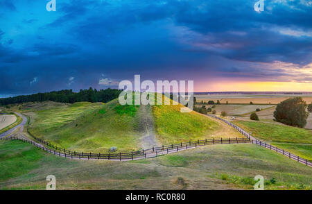 Sunset over Royal Mounds in Gamla Uppsala, Uppland, Sweden (HDR image - Stock Image