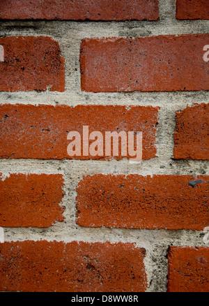 Close up of red brick wall - Stock Image