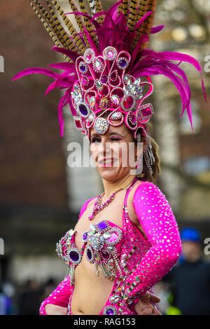 London School of Samba UK female dancer at London's New Year's Day Parade, UK. Winking. Exotic Brazilian colourful dancing - Stock Image
