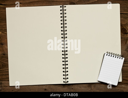 Blank ring bound scrapbook on a rustic wooden background with copy space for insertion of your message or design elements. - Stock Image