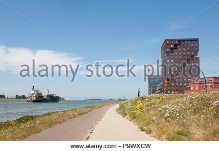 Maassluis The Netherlands Samskip Endurance container ship sailing along the Nieuwe Waterweg from Rotterdam in the direction of the North Sea past apa - Stock Image