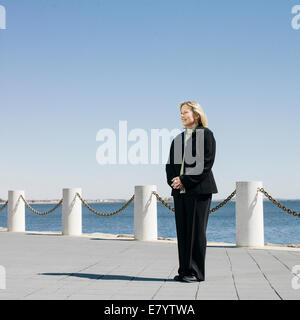 Middle-aged woman on seafront promenade - Stock Image