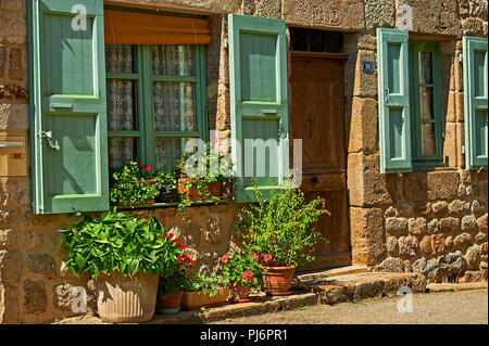 Saint Felicien, Ardeche department, Rhone Alps, France and a cottage front with windows and shutters - Stock Image