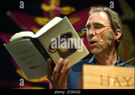 Will Self novelist reading from his novel Phone on stage at lectern during Hay Festival of Literature and the Arts - Stock Image