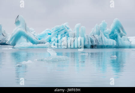 Beautiful bright blue floating icebergs drifting in the Jokulsarlon glacier lagoon, Iceland. - Stock Image
