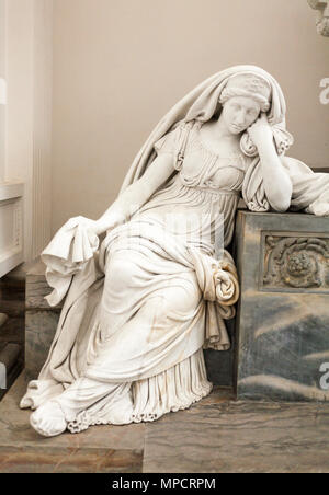 Marble sculpture of a reclining woman: An ornately carved mable of a woman resting her elbow on the her tomb is just one of the grandly carved burial boxes housed in the Cathedral. - Stock Image