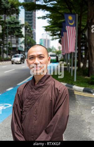 Vietnamese Buddhist Monk Touring Kuala Lumpur, Malaysia. - Stock Image