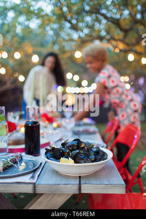 Mussels on dinner garden party table - Stock Image