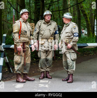 Woodhall Spa 1940s Festival - American soldiers military police MPs stood at the road block - Stock Image