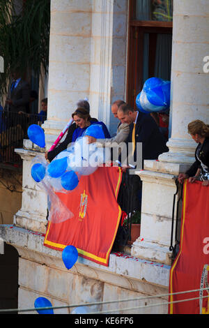 balloons released over the penitents at the Easter Sunday resersection Parade - Stock Image