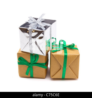 Pile of Gift boxes wrapped in brown paper isolated on white. - Stock Image