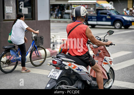 Funny animal, Bird, Parrot riding pillion on owners motorcycle - Stock Image