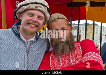Two bearded men, stallholders at an International Hanseatic Days market, Bergen, Norway, Europe - Stock Image