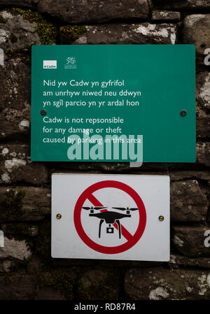 Signs on the wall of Llanthony Priory, in the Black Mountains, Brecon Beacons National Park, Monmouthshire, Wales. - Stock Image