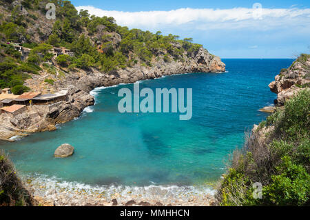An elevated view of Cala Deia beach on a warm summer`s day in Mallorca, Spain. - Stock Image