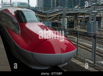 Super Komachi bullet train at Tokyo station. The Komachi plies the Akita route from Tokyo Japan - Stock Image
