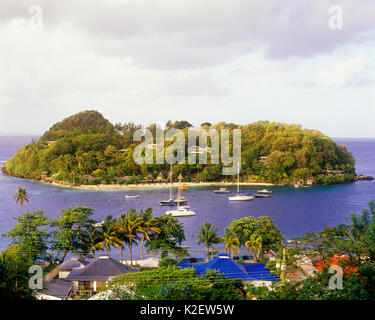 Young Island at sunrise.Young Island is a secluded 35-acre island resort with a pristine beach and stunning tropical gardens located just offshore fro - Stock Image