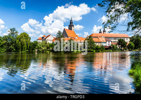 Castle Telc across pond. UNESCO World Heritage Site. South Moravia, Czech Republic. - Stock Image