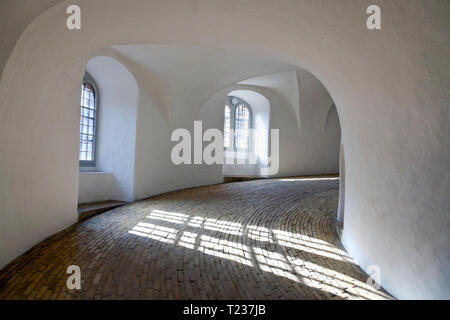 The spiral ramp entrance to the Round Tower, Rundetårn, at Nørregade in central Copenhagen. The oldest functioning observatory in Europe. - Stock Image