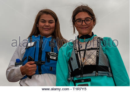 Schull, West Cork, Ireland. 28th Mar, 2019. Suannie Hurley and Caoimhe Teeling from Schull prepare for a day's sailing on the second day of the Munster Schools Team Racing Championships, which is being held at the Fastnet Marine and Outdoor Education Centre in Schull today. The competition comprises of 13 teams of 6 sailors with the winners going on to compete in the National Championships. Credit: Andy Gibson/Alamy Live News - Stock Image