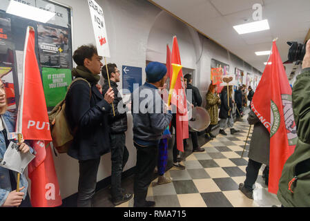 London, UK. 14th February 2019. The IWGB union and students inside the Richard Hoggart Building as they launch their campaign for Goldmsiths, University of London, to directly employ its security officers. Currently they are employed by CIS Security Ltd on low pay and minimal conditions of service, and CIS routinely flouts its legal responsibilities on statutory sick pay and holidays. Credit: Peter Marshall/Alamy Live News - Stock Image