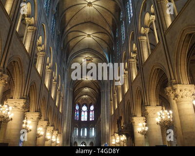 Interior of Notre-Dame cathedral in european capital city of Paris in France - Stock Image