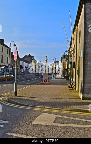 View of High Street in Cowbridge, with it's mix of local stores as well as national chain shops. Seen from the historic Town Hall and War Memorial. - Stock Image