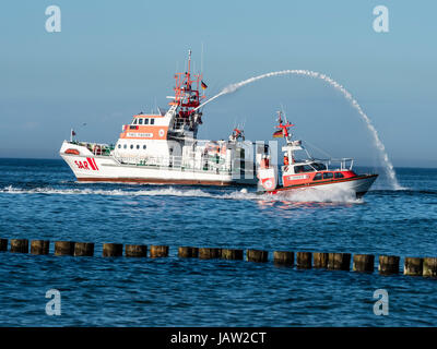Maritime emergency rescue cruiser, skill presentation at wharf of Zingst during festival 'Horizonte', Baltic - Stock Image