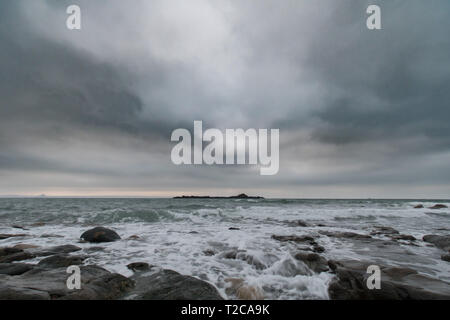 Mouseheole, Cornwall, UK. 1st Apr, 2019. UK Weather. After last weeks sunshine and warm weather, the first day of April was grey, cold and windy. Credit: Simon Maycock/Alamy Live News - Stock Image