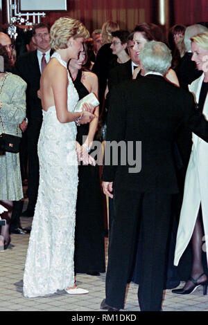 Diana, Princess of Wales is introduced to guests by fashion designer Ralph Lauren, right, during a charity gala fundraising event for the Nina Hyde Center for Breast Cancer Research September 24, 1996 in Washington, DC. - Stock Image