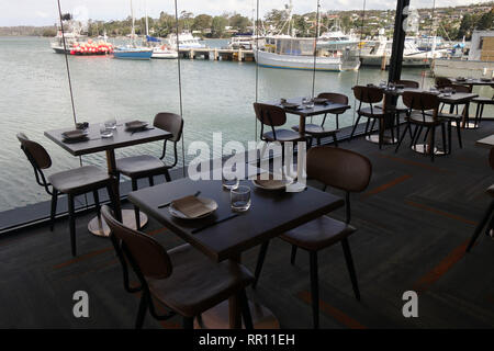 Tables with water views ready for guests at The Wharf Bar & Kitchen, St Helens, Tasmania, Australia. No PR - Stock Image