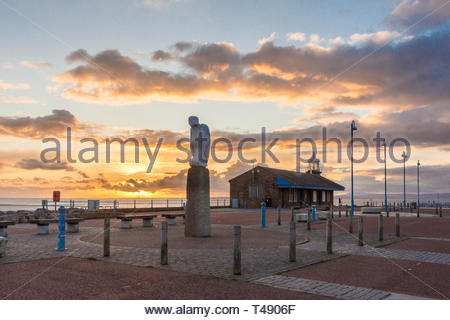 The mythical bird sculpture, part of the Tern Project, on the Stone Jetty at Morecambe, Lancashire, England, UK as the sun sets over Morecambe Bay - Stock Image