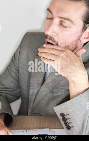 Tired businessman - Stock Image