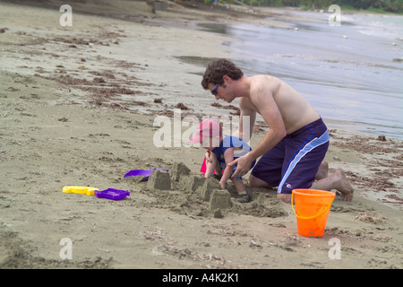 Father and son playing on a Puerto Rican beach. - Stock Image