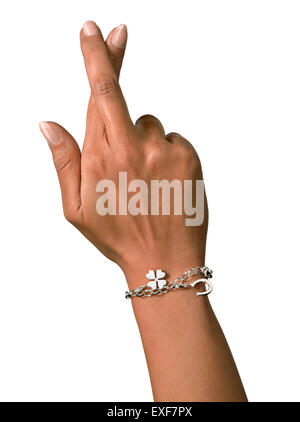 A shot of a lady crossing her finger - Stock Image