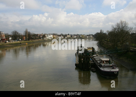 View of the River Thames from Kew Bridge, Looking East, Kew, Richmond, Surrey, UK - Stock Image