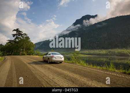 A sedan parked on a dirt road, Silver Lake, Silver Lake Provincial Park, British Columbia, Canada - Stock Image
