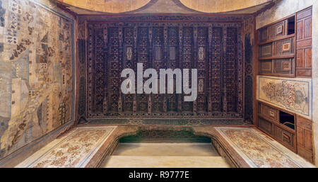 Wooden ceiling decorated with floral pattern decorations, mural, and built-in wooden cupboards at ottoman historic Beit El Set Waseela building - Stock Image